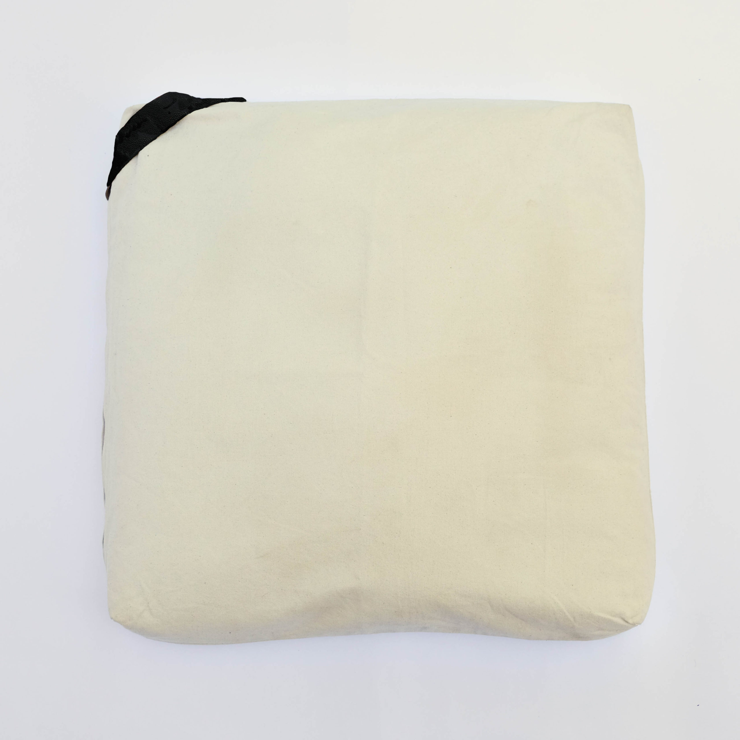floor cushion naturally dyed sustainable organic cotton borrego sand black front view