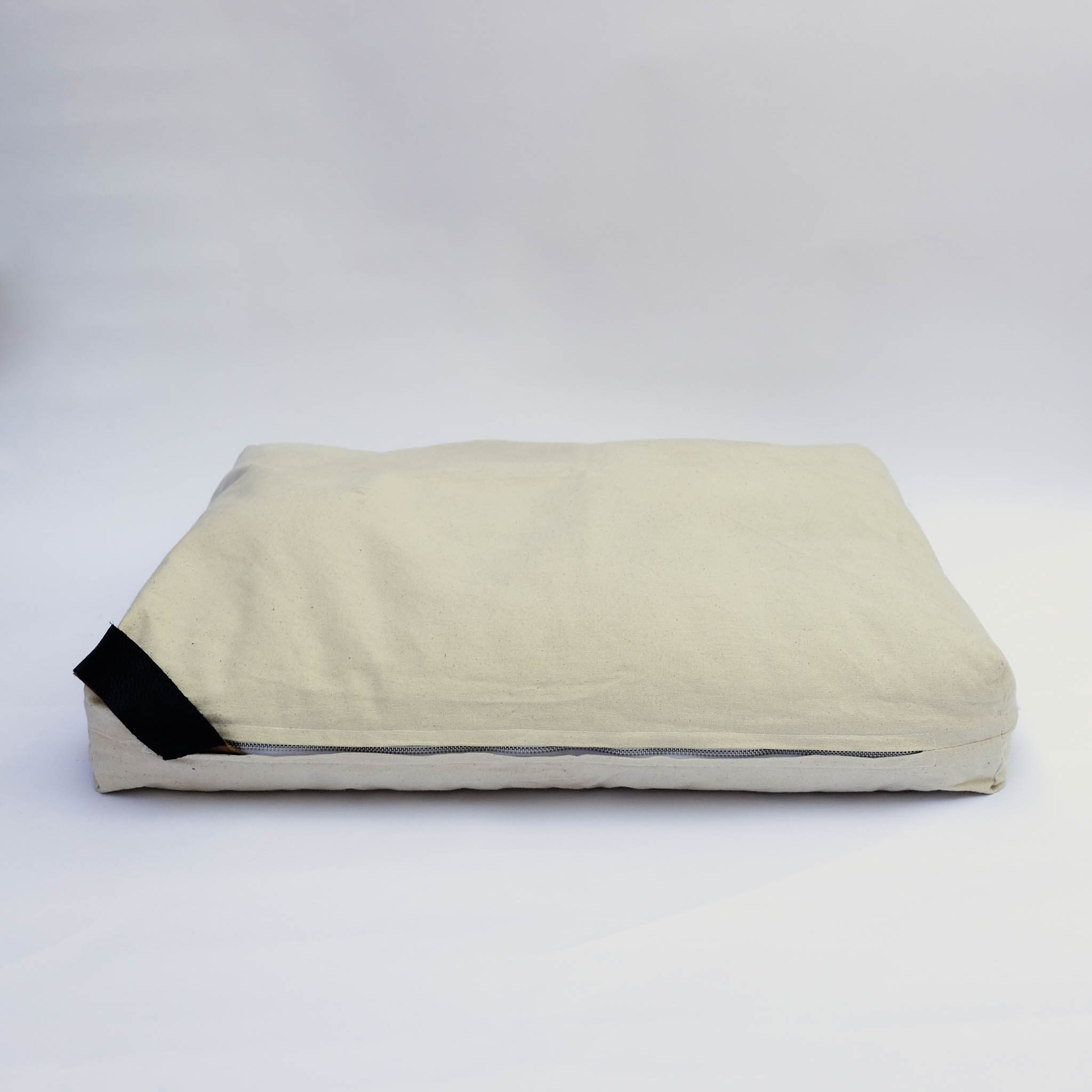 floor cushion naturally dyed sustainable organic cotton borrego sand black side view
