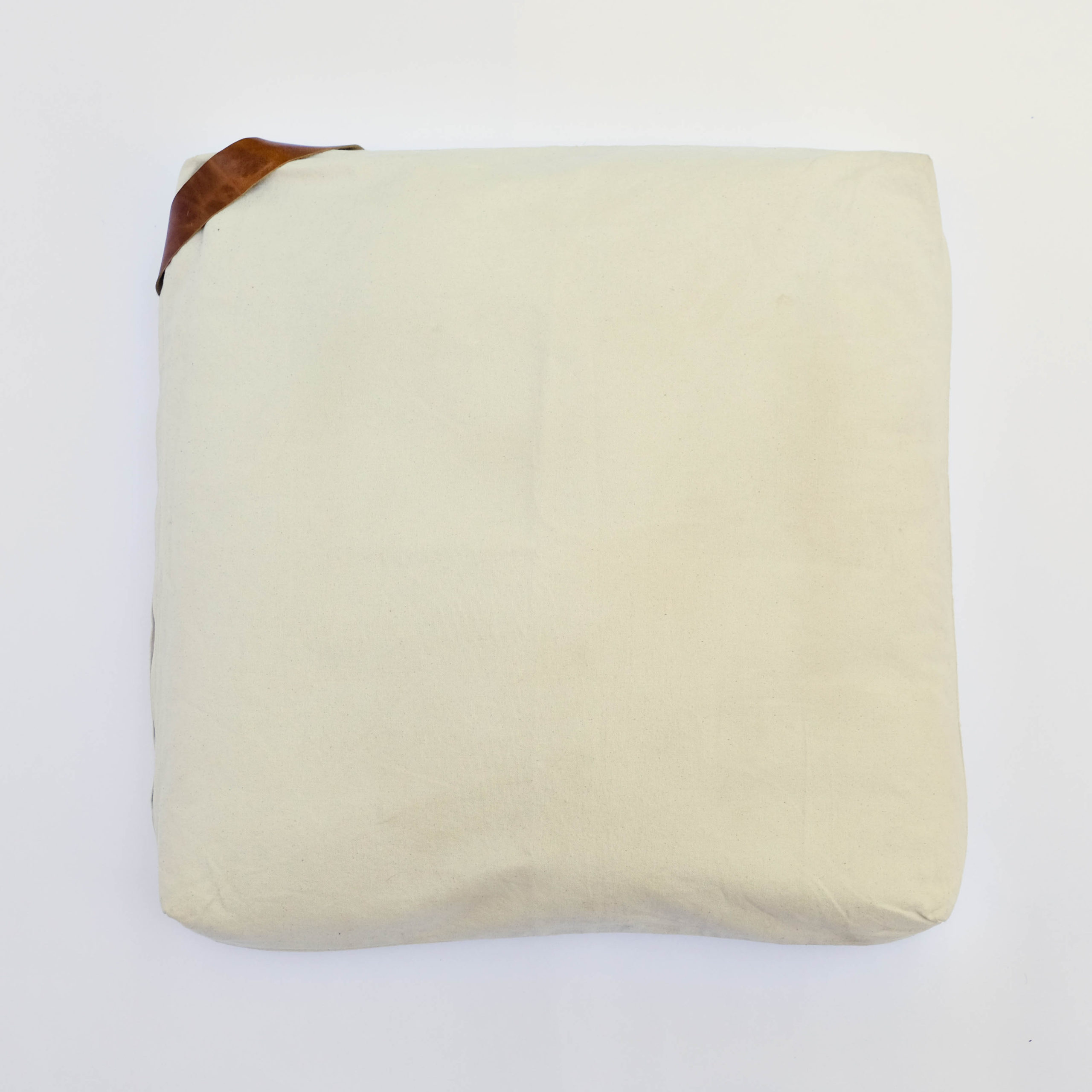 floor cushion naturally dyed sustainable organic cotton borrego sand cognac front view