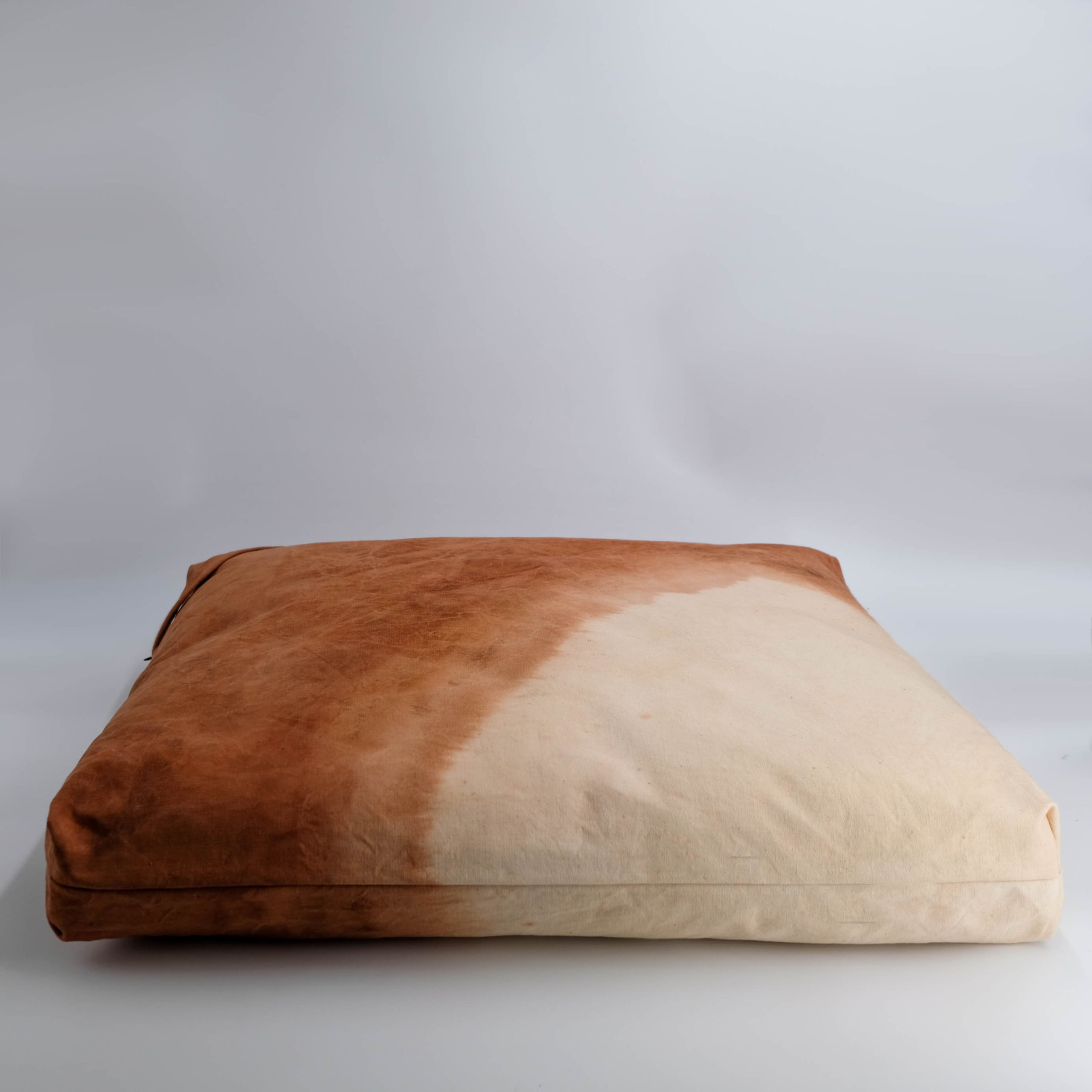 floor cushion naturally dyed sustainable organic cotton desert sunset side view
