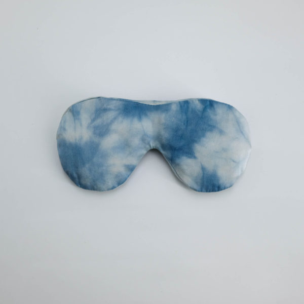 herbal eye pillow naturally dyed silk cover herb filled blue sky day front view