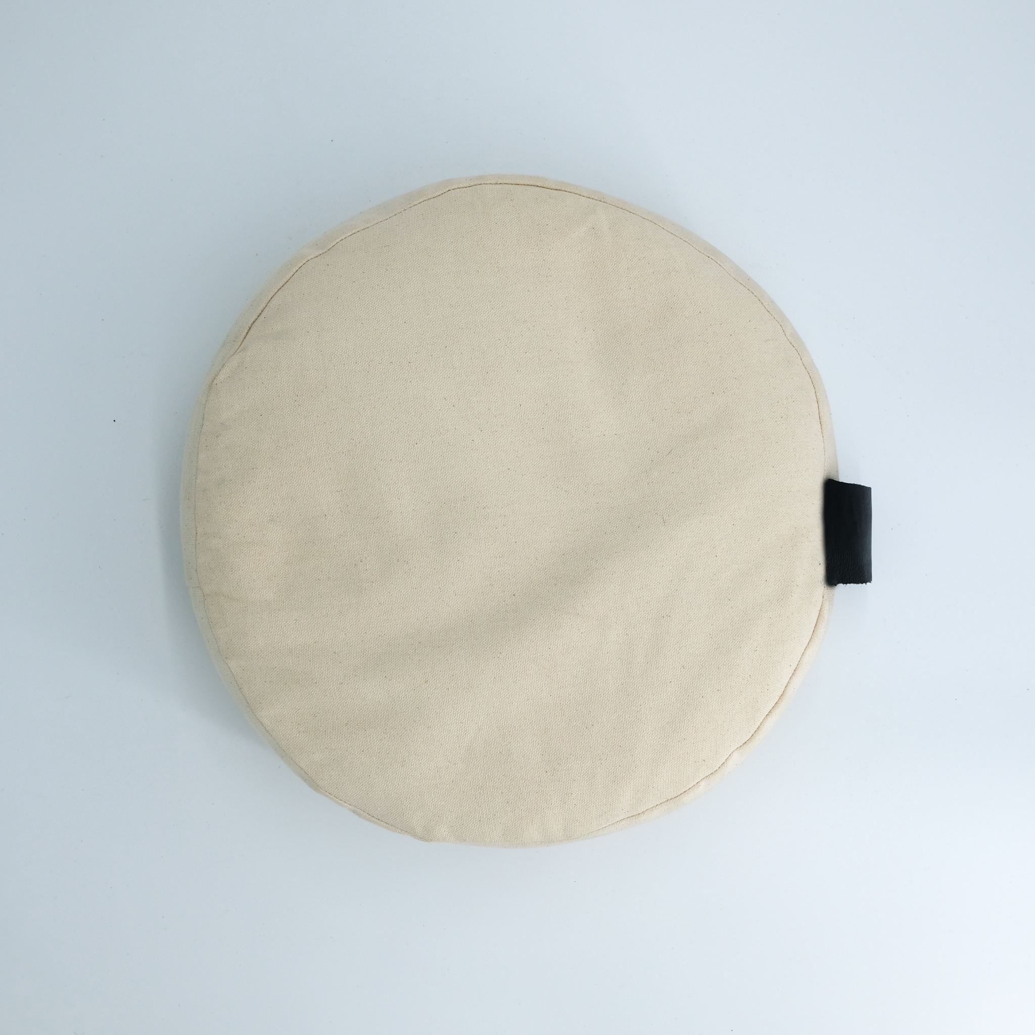 meditation cushion naturally dyed sustainable organic cotton black leather handle top view